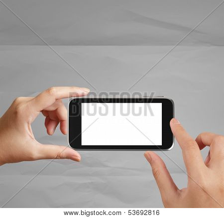 Woman Hand Holding The Phone Tablet Touch Computer Gadget On Crumpled Paper Background