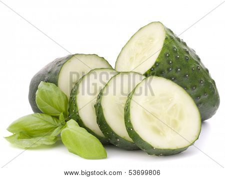 Sliced cucumber vegetable and basil leaves still life isolated on white background cutout