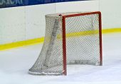 stock photo of bandy stick  - an ice hockey net during a game - JPG