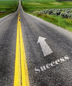Road to success with painted double yellow lines