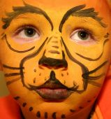 image of face painting  - little boy with lion face painting  - JPG