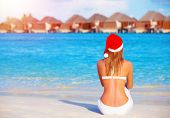 New Year celebration on Maldives, travel on winter holidays to summer destinations, back side, wearing red Santa Claus hat poster