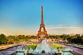 stock photo of fountains  - Eiffel Tower seen from fountain at Jardins du Trocadero at a sunny summer day - JPG