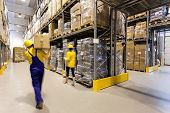 stock photo of racks  - Warehouse worker with box and manager controlling products - JPG