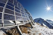 pic of cluster  - Big cluster of solar panels on a mountain peak - JPG
