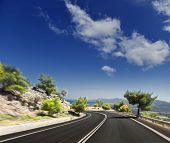 Winding road on the background of the Greek mountains. blurred motion