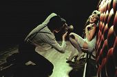 stock photo of vaudeville  - Photographer is taking a picture of a beautiful cabaret girls - JPG