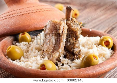 Moroccan tagine with lamb ribs, couscous and olives