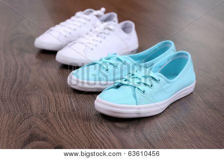 Female sneakers on floor