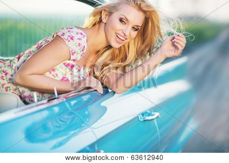 Young woman driving vintage car