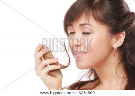 Brunette Smelling Coconut