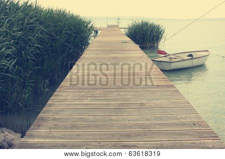Pier And Boat At The Lakeside