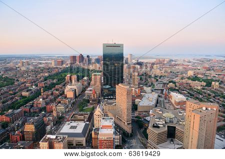 Urban city aerial view. Boston aerial view with skyscrapers at sunset with city downtown skyline.
