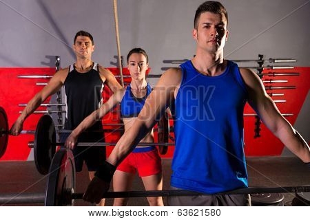Barbell weight lifting group workout exercise at gym box