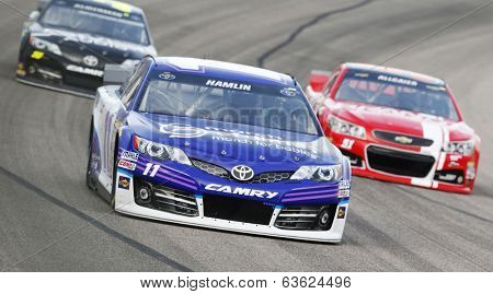 Fort Worth, TX - Apr 04, 2014:  Denny Hamlin (11) takes to the track for a practice session for the Duck Commander 500 at Texas Motor Speedway in Fort Worth, TX.