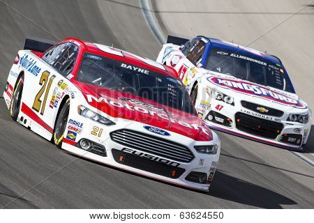 Las Vegas , NV - Mar 09, 2014:  Trevor Bayne (21) battles for position during the Kobalt Tools 400 race at the Las Vegas Motor Speedway  in Las Vegas , NV.