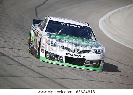 Fort Worth, TX - Apr 04, 2014:  Kyle Busch (18) brings his race car through the turns during a practice session for the Duck Commander 500 at Texas Motor Speedway in Fort Worth, TX.