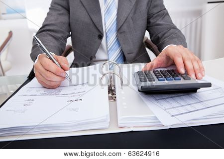 Businessman Calculating Bills