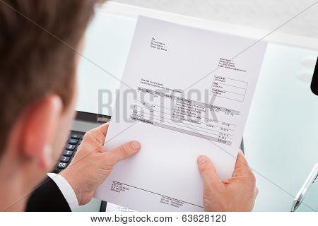 Businessman Holding Invoice Paper