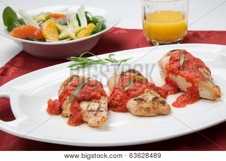 Grilled Chicken Breast With Tomato Tarragon Sauce.