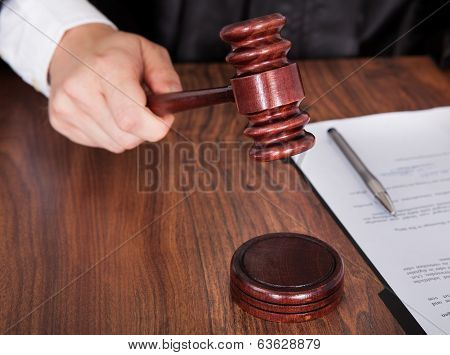 Male Judge Striking The Gavel