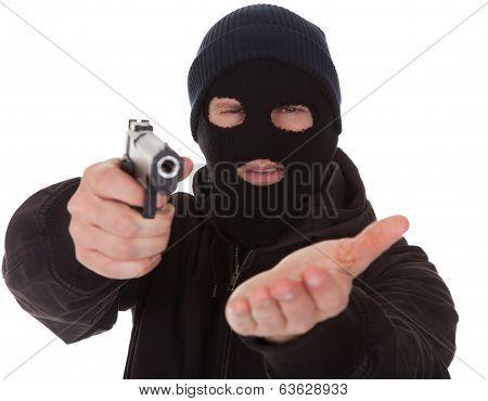 Burglar Wearing Mask Holding Gun