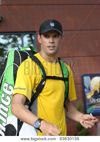 Grand Slam champions Bob Bryan signing autographs after match at US Open 2013