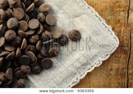 Chocolate Chips On A Rustic Surface