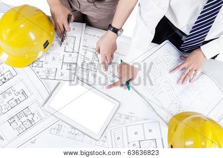 Architects Discussing Blueprint