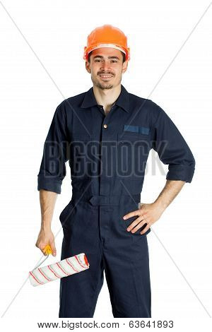 young worker standing with roller for painting isolated on white background