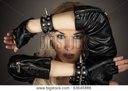woman with blue eyes in a leather jacket