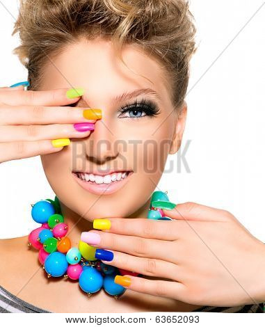 Manicure. Colorful Nails. Beauty Girl with Colorful Makeup, Nail polish and Accessories. Colourful Studio Shot of Funny Woman. Vivid Colors. Bright Nail polish and fashion