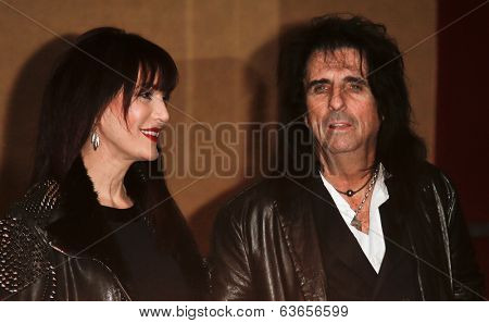 NEW YORK-APR 17: Sheryl Goddard (L) and Alice Cooper attend the 'Super Duper Alice Cooper' premiere during the 2014 TriBeCa Film Festival at Chelsea Bow Tie Cinemas on April 17, 2014 in New York City.