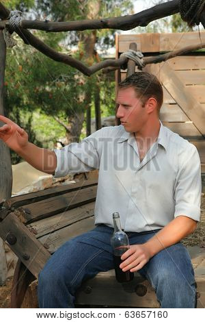 young happy white caucasion man taste and enjoy red wine outdoor in in countryside