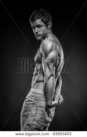 Strong Athletic Man Fitness Model Posing Triceps Muscle