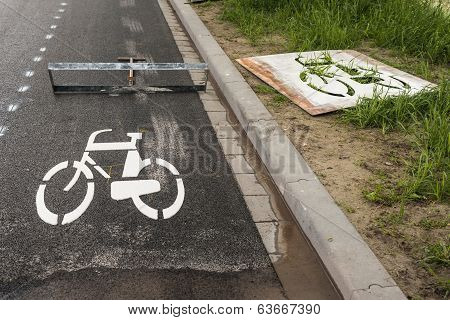 Freshly Affixed ??bicycle Symbol On Asphalt