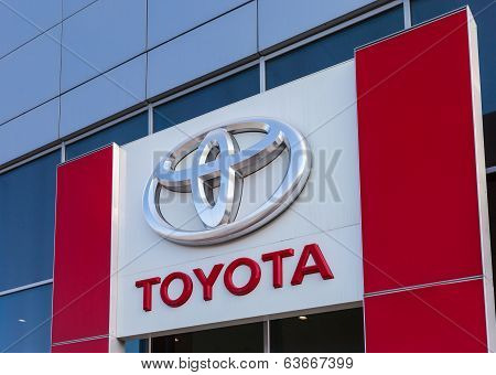 Samara, Russia - April 19, 2014: The Emblem Toyota On The Office Of Official Dealer. Toyota Motor Co