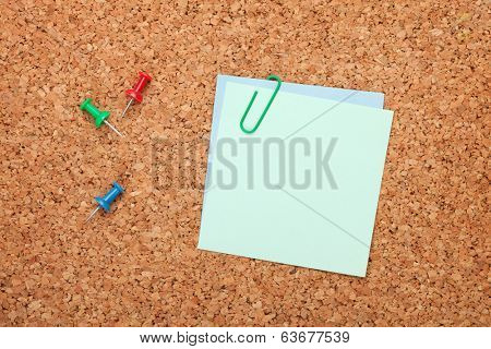 Blank postit note on cork wood notice board