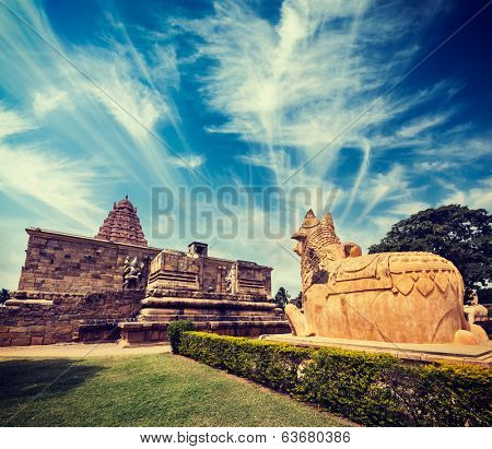 Vintage retro hipster style travel image of Hindu temple Gangai Konda Cholapuram with giant statue of bull Nandi. Tamil Nadu, India