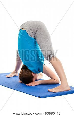 Yoga - young beautiful slender woman yoga instructor doing Wide Legged standing Forward Bend A (Prasarita Padottanasana A) asana exercise isolated on white background