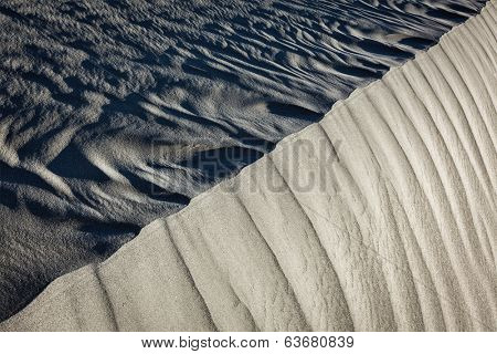 Shadow and light on Nubra Valley dunes sand close up on sunrise. Ladakh, India