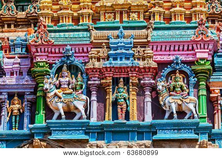 Shiva and Parvati on bull images. Sculptures on Hindu temple gopura (tower). Menakshi Temple, Madurai, Tamil Nadu, India