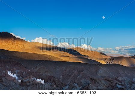Basgo Gompa (Tibetan Buddhist monastery) and Himalayan landscape on sunset and moonrise. Ladakh, India