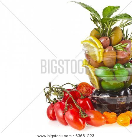 Border of olives dish with vegetables, herbs, spices isolated on a white background