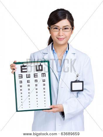 Optician woman showing eye exam chart
