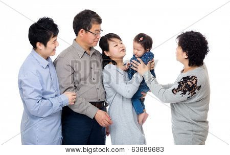 Happy family looking at little girl