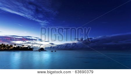 Starry night on Maldives, dark blue night sky over beach resort, beautiful nighttime seascape, luxury summer vacation and tourism concept