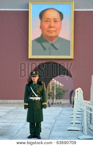 BEIJING, CHINA - APR 6: Soldier on duty at Tiananmen on April 6, 2013 in Beijing, China. Tiananmen is a famous monument in Beijing and serves as a national symbol.