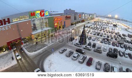 SAMARA, RUSSIA - JAN 05, 2014 : Aerial view to territory of store Mega in Samara with car parking in evening.