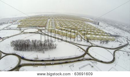 RUSSIA, SAMARA - JAN 5, 2014: Aerial view to Koshelev project with identical houses near superstore Mega.